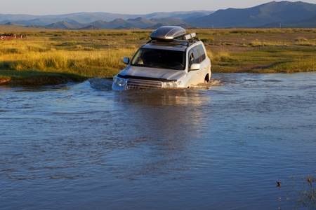 4 wheel: 4WD crossing river in the northen Mongolia