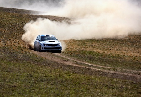 racecar: ALMATY, KAZAKHSTAN - APRIL 9: Smailov and Rusov (7) in action at auto competition  Editorial