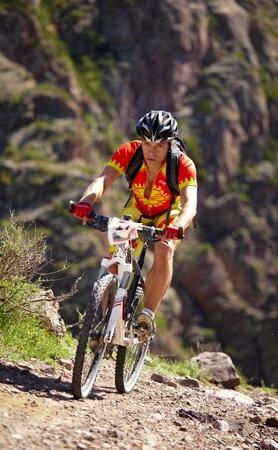 mountain biker: ALMATY, KAZAKHSTAN - MAY 2: A.Monastyrsky (N17) in action at Adventure mountain bike cross-country marathon in mountains