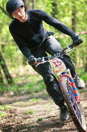 bikecross: ALMATY, KAZAKHSTAN - APRIL 15: E.Korjov (15*) in action at cross-country relay race April 15, 2012 in Almaty, Kazakhstan. Editorial