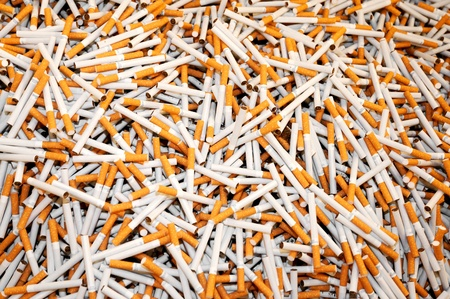 disarray: A huge pile of smoking cigarettes scattered in disarray