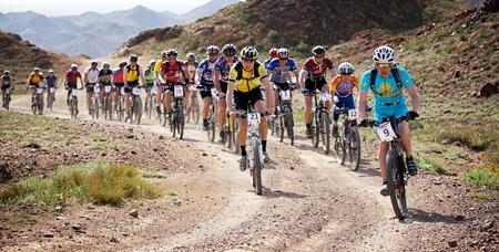 bikercross: ALMATY, KAZAKHSTAN - MAY 1: Adventure mountain bike cross-country marathon in desert  Editorial
