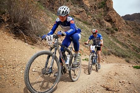 bike trail: ALMATY, KAZAKHSTAN - MAY 1: R.Fayzulin (N12) in action at Adventure mountain bike cross-country marathon in desert  Editorial