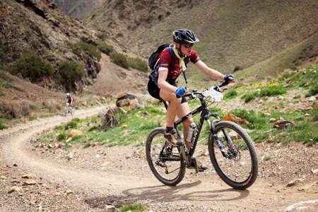 bikercross: ALMATY, KAZAKHSTAN - MAY 1: V.Philipchuk (N22) in action at Adventure mountain bike cross-country marathon in desert