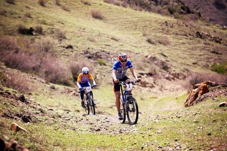 bikercross: ALMATY, KAZAKHSTAN - May 2: J.Satkynaliev (N1) in action at Adventure mountain bike cross-country marathon in desert  Editorial