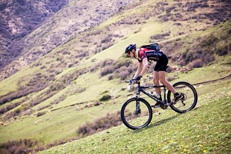 bikercross: ALMATY, KAZAKHSTAN - MAY 2: Vladimar Philipchuk (N22) in action at Adventure mountain bike marathon in desert