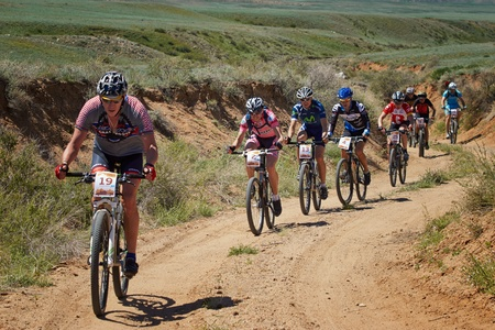 bicycle race: ALMATY, KAZAKHSTAN - MAY 5: i.Popov (N2) and other in action at Adventure mountain bike cross-country marathon in mountains