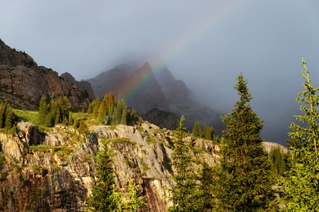 Rainbow in the Dzungarian Alatau mountains, Kazakhstan photo