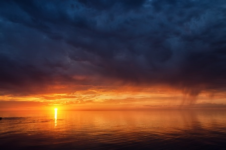 Thunderstorm sky and sunset on the great lake Balkhash, Kazakhstan  photo