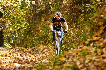 bikercross: ALMATY REGION, KAZAKHSTAN - OCTOBER 13: V.Kachanov (N164) in action at mountain bike sports event Red Bull Mountain Rage October 13, 2013 in Almaty region, Kazakhstan.