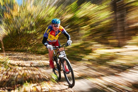 ALMATY REGION, KAZAKHSTAN - OCTOBER 13: E.Kazantcev (N163) in action at mountain bike sports event Red Bull Mountain Rage October 13, 2013 in Almaty region, Kazakhstan.  Editorial