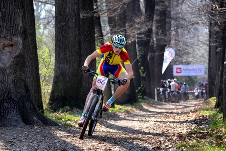 bikecross: ALMATY, KAZAKHSTAN - APRIL 19, 2014: S.Kovalchuk (66*) in action at cross-country competition Open season - Bikes relay 2014  Editorial