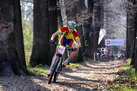 bikercross: ALMATY, KAZAKHSTAN - APRIL 19, 2014: S.Kovalchuk (66*) in action at cross-country competition Open season - Bikes relay 2014  Editorial