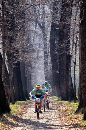 bikecross: ALMATY, KAZAKHSTAN - APRIL 19, 2014: A.Mayer (05*) in action at cross-country competition Open season - Bikes relay 2014
