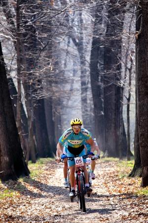 bikercross: ALMATY, KAZAKHSTAN - APRIL 19, 2014: A.Mayer (05*) in action at cross-country competition Open season - Bikes relay 2014