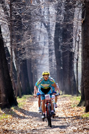 ALMATY, KAZAKHSTAN - APRIL 19, 2014: A.Mayer (05*) in action at cross-country competition Open season - Bikes relay 2014