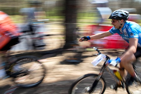 bikecross: ALMATY, KAZAKHSTAN - APRIL 19, 2014: I.Popov (11) in action at cross-country competition Open season - Bikes relay 2014