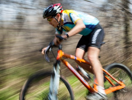 ALMATY, KAZAKHSTAN - APRIL 19, 2014: Unknown rider in action at cross-country competition Open season - Bikes relay 2014