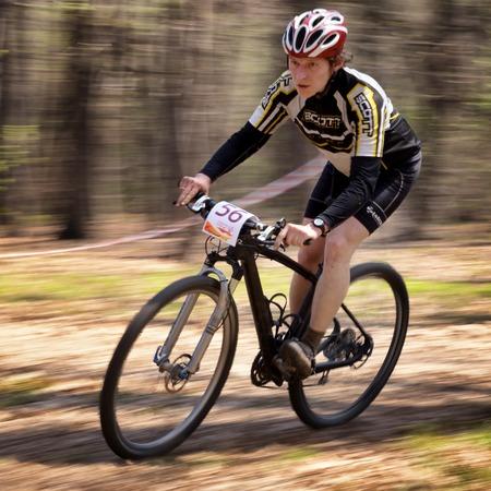 ALMATY, KAZAKHSTAN - APRIL 19, 2014: S.Kachanov (N56) in action at cross-country competition Open season - Bikes relay 2014