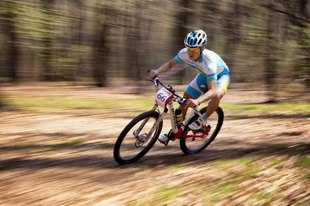 ALMATY, KAZAKHSTAN - APRIL 19, 2014: K.Kazatncev (N66) in action at cross-country competition Open season - Bikes relay 2014