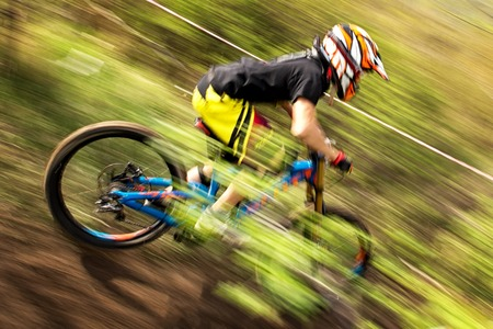 mountain biker: ALMATY, KAZAKSTAN - APRIL 27, 2014: Unknown rider in action at Mountain Bike sports event Downhill Koktybe.