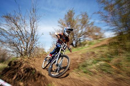 bike trail: ALMATY, KAZAKSTAN - APRIL 27, 2014: Unknown rider in action at Mountain Bike sports event Downhill Koktybe.