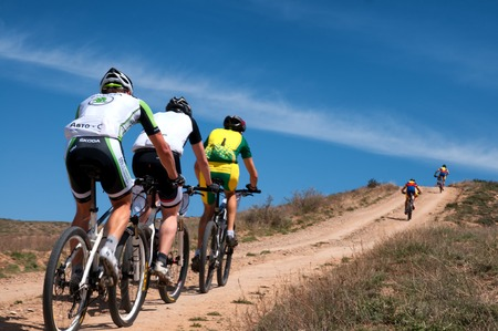 ALMATY, KAZAKSTAN - MAY 01, 2014: Unidentified bikers in action at Adventure mountain bike cross-country marathon in mountains Jeyran Trophy 2014
