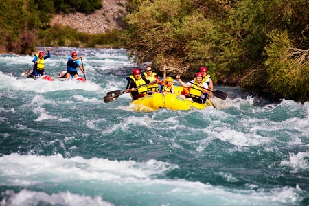 river rafting: ALMATY REGION, KAZAKSTAN - JUNE 07, 2014: Athletes training on rafts and children ride on the river Chilik