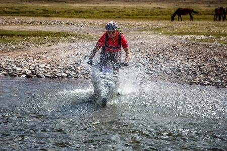 bikercross: ALMATY, KAZAKHSTAN - SEPTEMBER 09, 2014: A.Kulkin (N17) in action at Adventure mountain bike cross-country marathon Marathon Bartogay-Assy-Batan 2012.