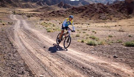 bikercross: ALMATY, KAZAKHSTAN - SEPTEMBER 09, 2014: N.Tlegenov (N6) in action at Adventure mountain bike cross-country marathon Marathon Bartogay-Assy-Batan