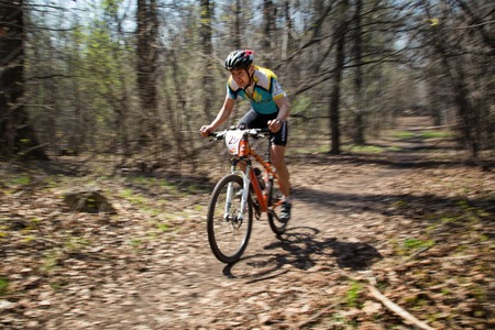 bikecross: ALMATY, KAZAKHSTAN - APRIL 19, 2014: A.Nuriev (N29) in action at cross-country competition Open season - Bikes relay 2014