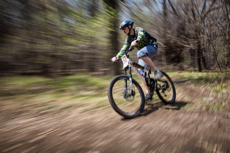 ALMATY, KAZAKHSTAN - APRIL 19, 2014: S.Shramkov (N4) in action at cross-country competition Open season - Bikes relay 2014