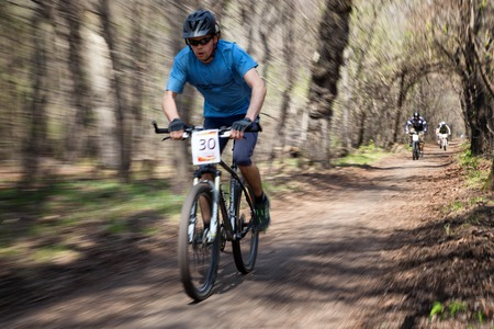 ALMATY, KAZAKHSTAN - APRIL 19, 2014: I.Genin (N30) in action at cross-country competition Open season - Bikes relay 2014 Editorial