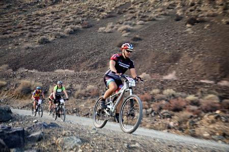 bikercross: ALMATY, KAZAKHSTAN - SEPTEMBER 09, 2014: I.Baranov (N26) in action at Adventure mountain bike cross-country marathon Marathon Bartogay-Assy-Batan