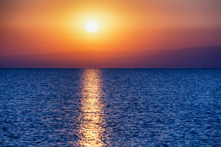 horizon over water: Sunrise on Alakol lake in Kazakhstan