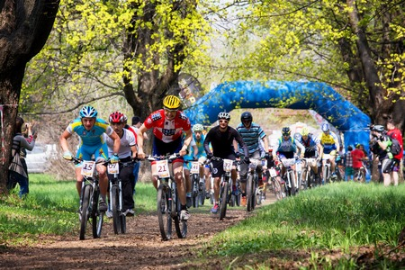 bikercross: ALMATY, KAZAKHSTAN - APRIL 19, 2015: Group of bikers started in action at cross-country competition Open season - Bikes relay 2015
