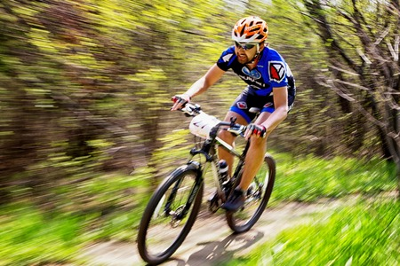 bikecross: ALMATY, KAZAKHSTAN - APRIL 19, 2015: P.Kim (N27) in action at cross-country competition Open season - Bikes relay 2015