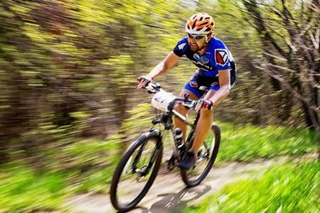 ALMATY, KAZAKHSTAN - APRIL 19, 2015: P.Kim (N27) in action at cross-country competition Open season - Bikes relay 2015