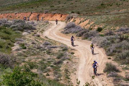 bikercross: ALMATY, KAZAKHSTAN - MAY 1, 2015: Group of competitors in action at Adventure mountain bike marathon Jeyran Trophy 2015 Editorial