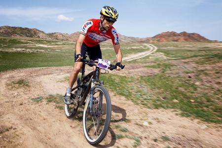 bikercross: ALMATY, KAZAKHSTAN - MAY 1, 2015: M.Balanenko (N18) in action at Adventure mountain bike marathon Jeyran Trophy 2015 Editorial