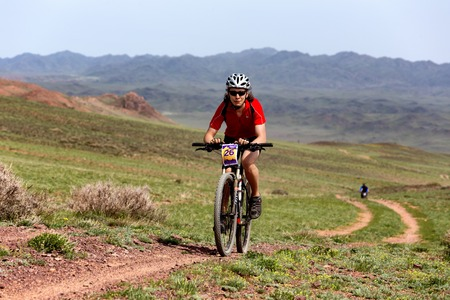 bikercross: ALMATY, KAZAKHSTAN - MAY 1, 2015: M.Getmanchuk (N26) in action at Adventure mountain bike marathon Jeyran Trophy 2015
