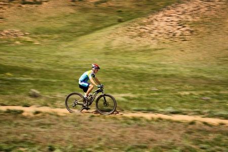 bikercross: ALMATY, KAZAKHSTAN - MAY 1, 2015: G.Torgautov (N14) in action at Adventure mountain bike marathon Jeyran Trophy 2015