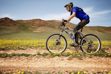 bikercross: ALMATY, KAZAKHSTAN - MAY 1, 2015: A.Ledyaev (N15) in action at Adventure mountain bike marathon Jeyran Trophy 2015