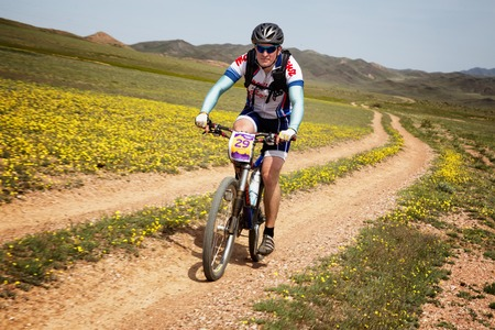 bikercross: ALMATY, KAZAKHSTAN - MAY 1, 2015: E.Asafov (N29) in action at Adventure mountain bike marathon Jeyran Trophy 2015 Editorial