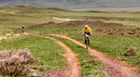 bikercross: ALMATY, KAZAKHSTAN - MAY 1, 2015: N.Eleusizov (N13) in action at Adventure mountain bike marathon Jeyran Trophy 2015