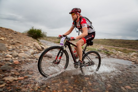 bikercross: ALMATY, KAZAKSTAN - MAY 02, 2015: A.Kovalgonov (N10) in action at Adventure mountain bike cross-country marathon in mountains Jeyran Trophy 2015 Editorial