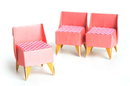 folding chair: Three origami chairs on a white background