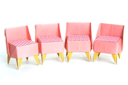 Four origami chairs on a white background Stock Photo