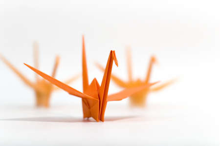 3 origami birds on a white background Stock Photo