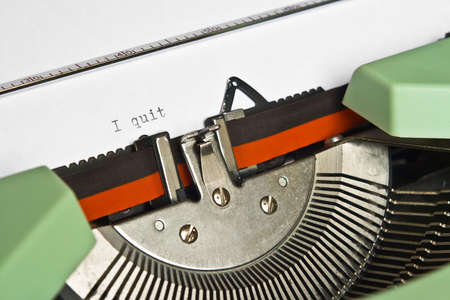 typebar: Close-up of an old typewriter with the word I quit typed Stock Photo